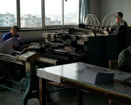 中国産折り機(東北財経大学印刷場) © 有限会社田中印刷所